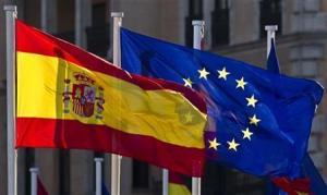 A European Union flag flies next to a Spanish flag in Madrid